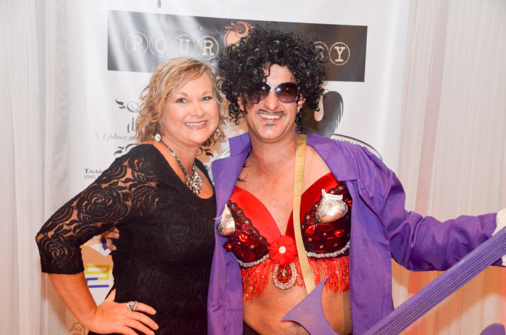 couple posing for picture at Bras for a Cause Gulf Coast