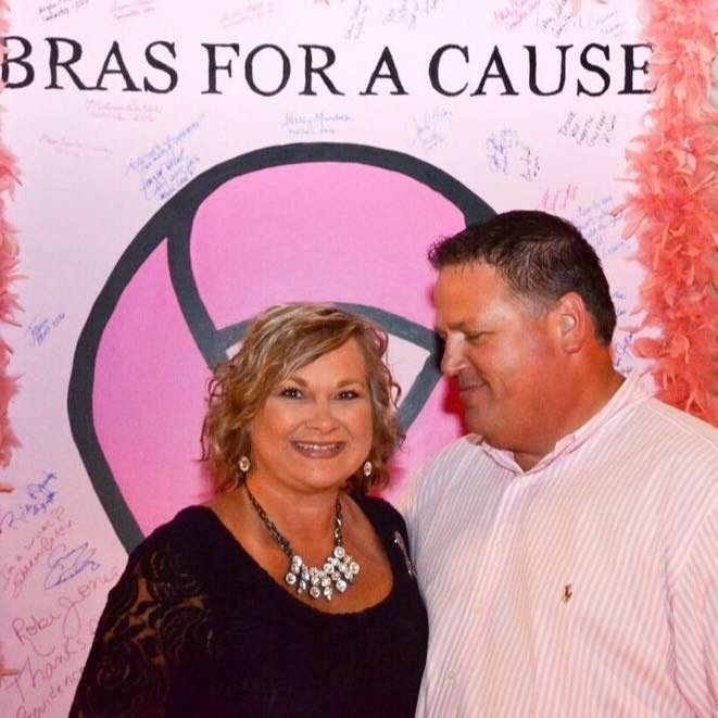couple in front of bras for a cause signature wall