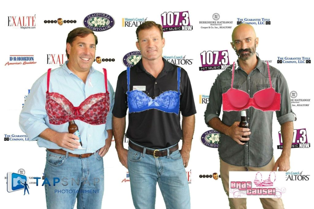 Three men in bras taking photo Bras for a Cause Gulf Coast
