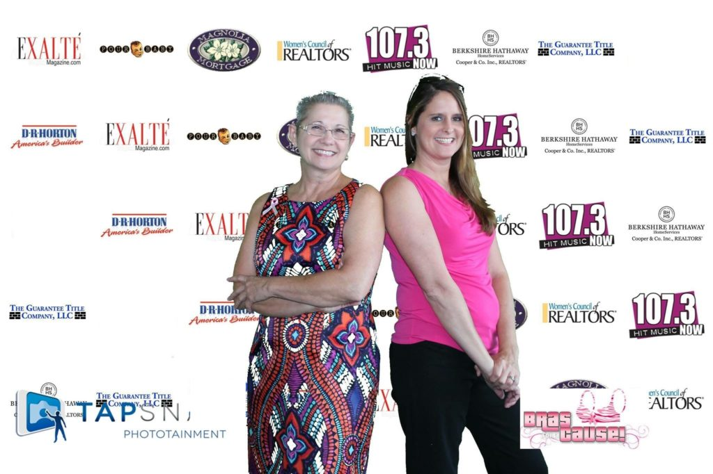 two women backdrop photo Bras for a Cause Gulf Coast