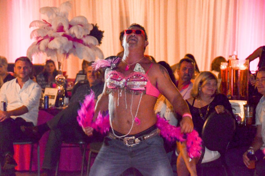 Man dancing at Bras for a Cause Gulf Coast